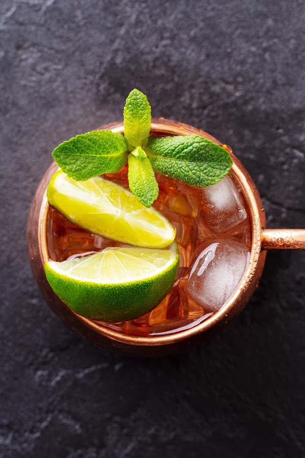 warm ginger ale with lemon lime and mint