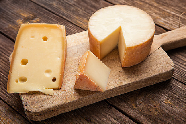 Various hard Cheeses on wooden background