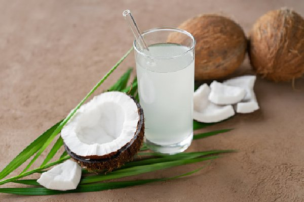 fresh coconuts and coconut water in glass