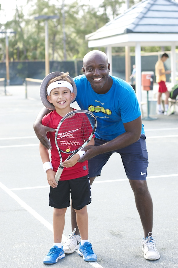 boy with tennis coach