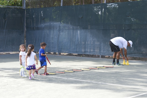 little kids playing tennis