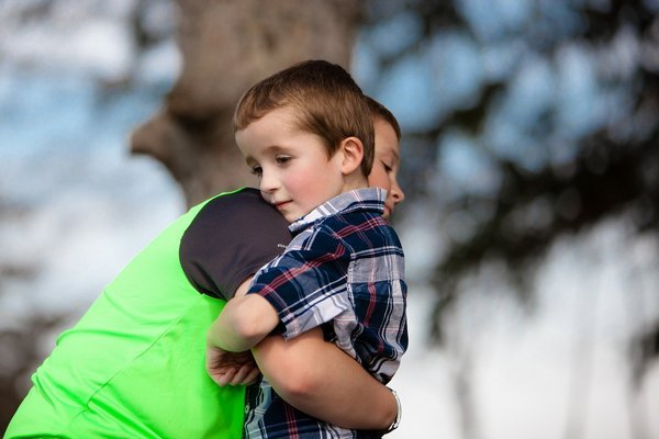 kid forced to give a hug