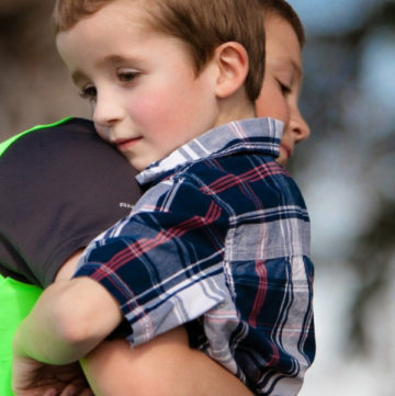 Forcing kids to give hugs against their will sends a very dangerous message! Find out what it is and what kids can do instead.