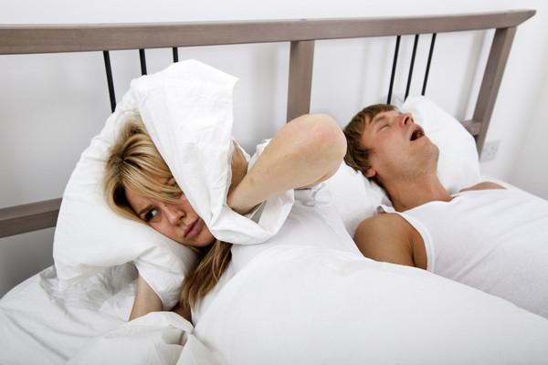 Your partner's snoring is costing you years of your life