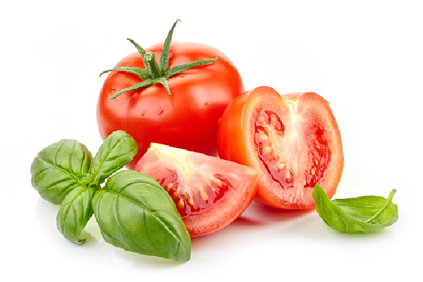 fresh tomatoes and basil leaves, great companion plants for your garden