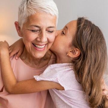 maternal grandmother hugging her grandchild